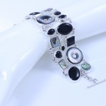 Sterling silver bracelet with onyx, abalone & mother-of-pearl